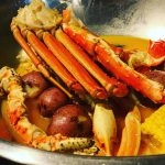 Image of crab legs and potatoes