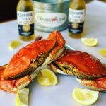 Image of crabs, sliced lemons and beer